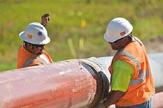 Protestors attempt to block replacement Enbridge oil pipeline in Michigan